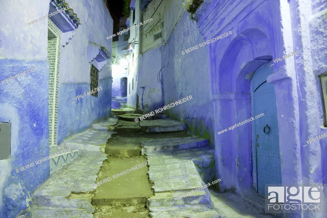 Stock Photo: alley with blue houses and stairway at night, Chefchaouen, Morocco.