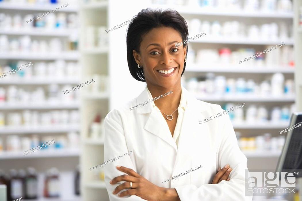 Stock Photo: African female pharmacist with arms crossed.