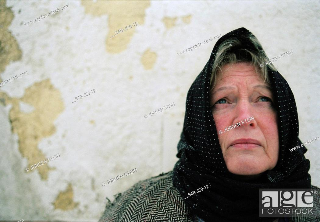 Stock Photo: Senior woman with kerchief.