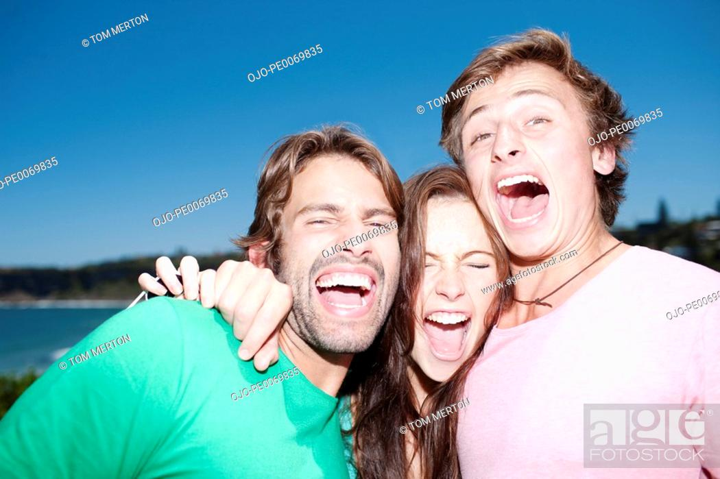 Stock Photo: Friends hugging and laughing.