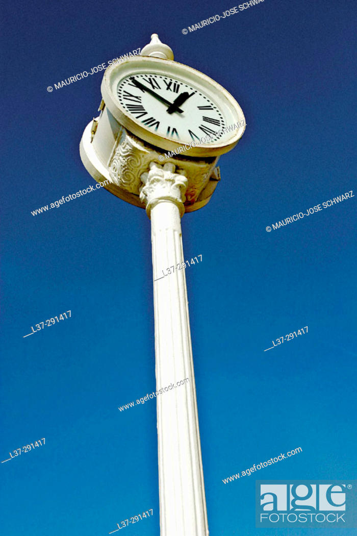 Stock Photo: Public clock seen from below against a deep blue sky.