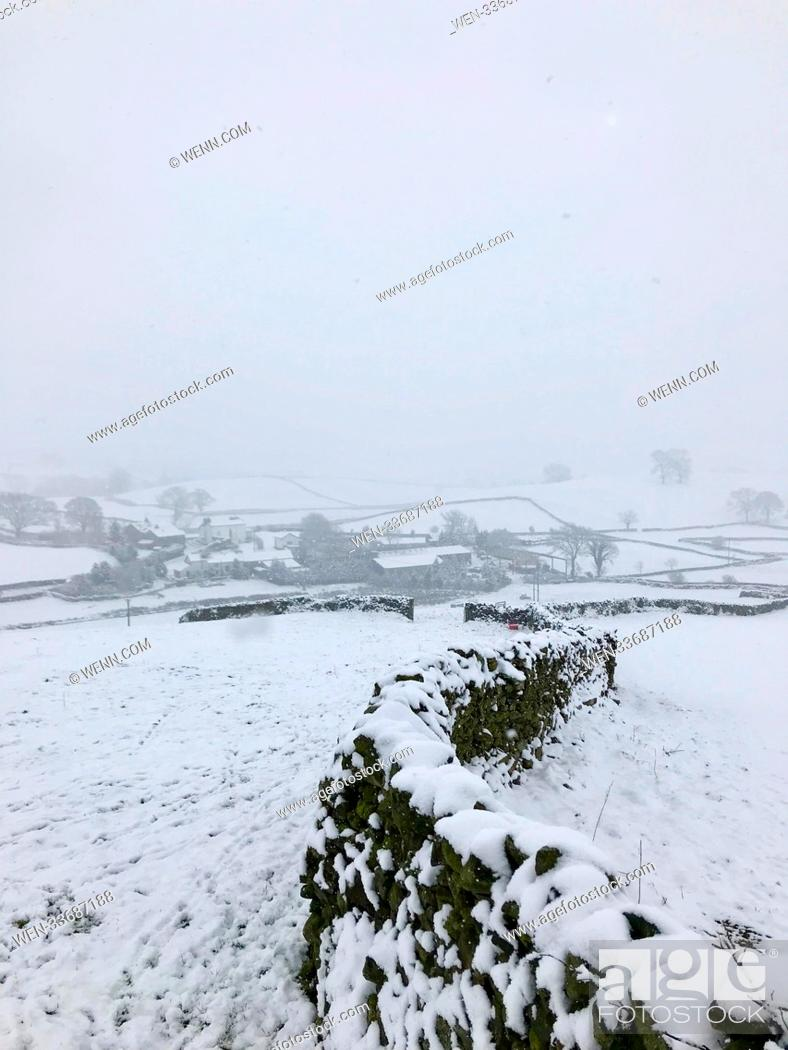 Stock Photo: Heavy snowfall today in the North of England sets the scene for a winter wonderland in rural Cumbria Featuring: Atmosphere Where: New Hutton, Cumbria.