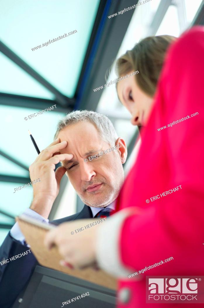 Stock Photo: Business executives working in an office corridor.