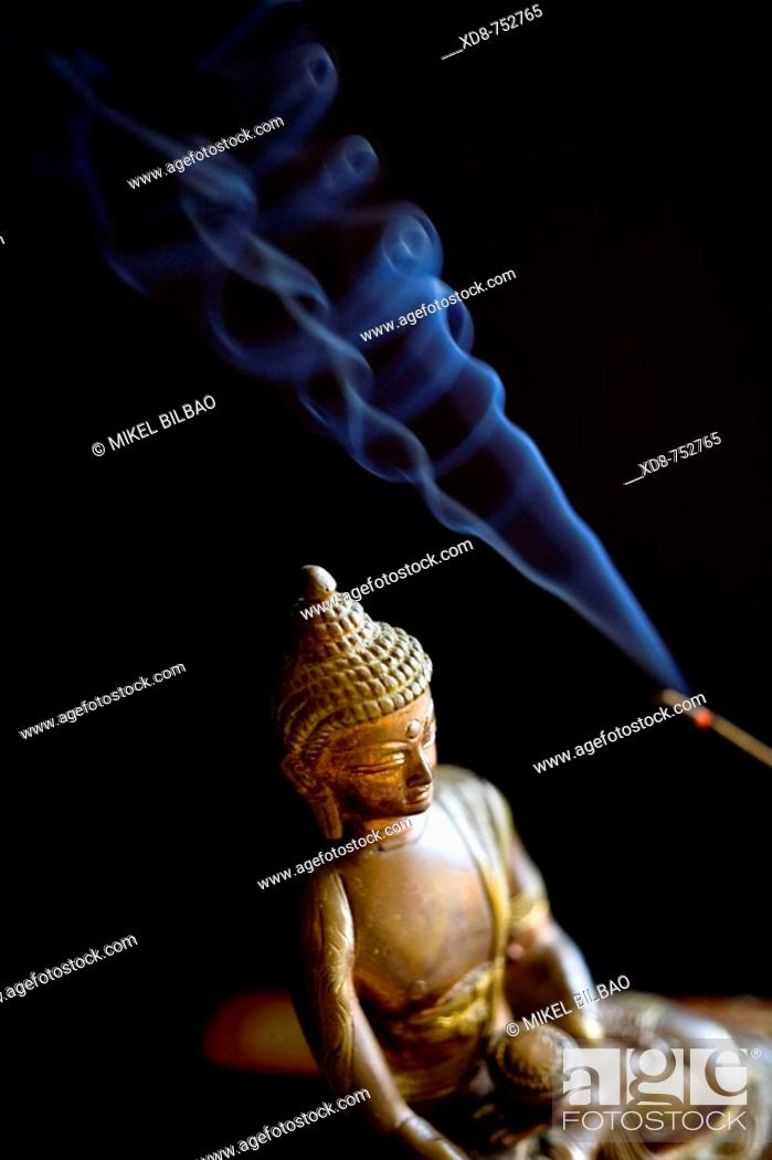 Stock Photo: Buddha little statue with incense sticks.