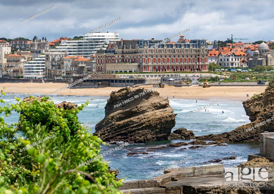 Stock Photo: 21 June 2019, France (France), Biarritz: The Hotel du Palais (M) on the beach of Biarritz. The upcoming G7 summit will take place here from 24-26.08.