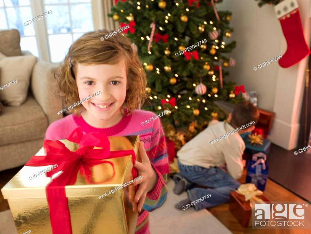 Stock Photo: Girl holding Christmas gift.