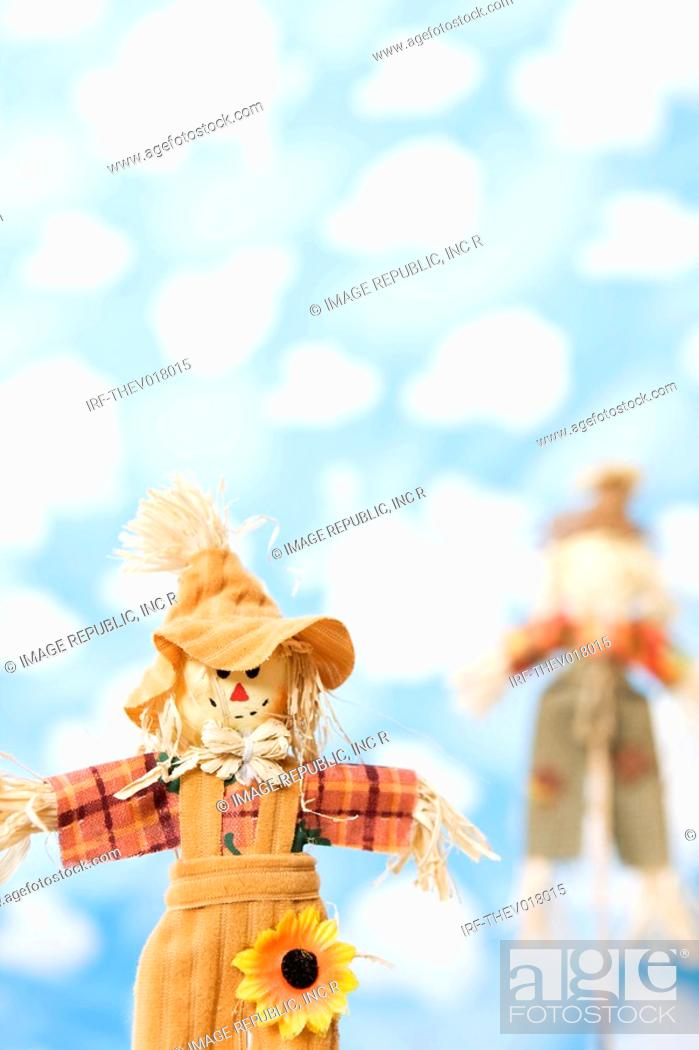 Stock Photo: wallpaper and scarecrow.