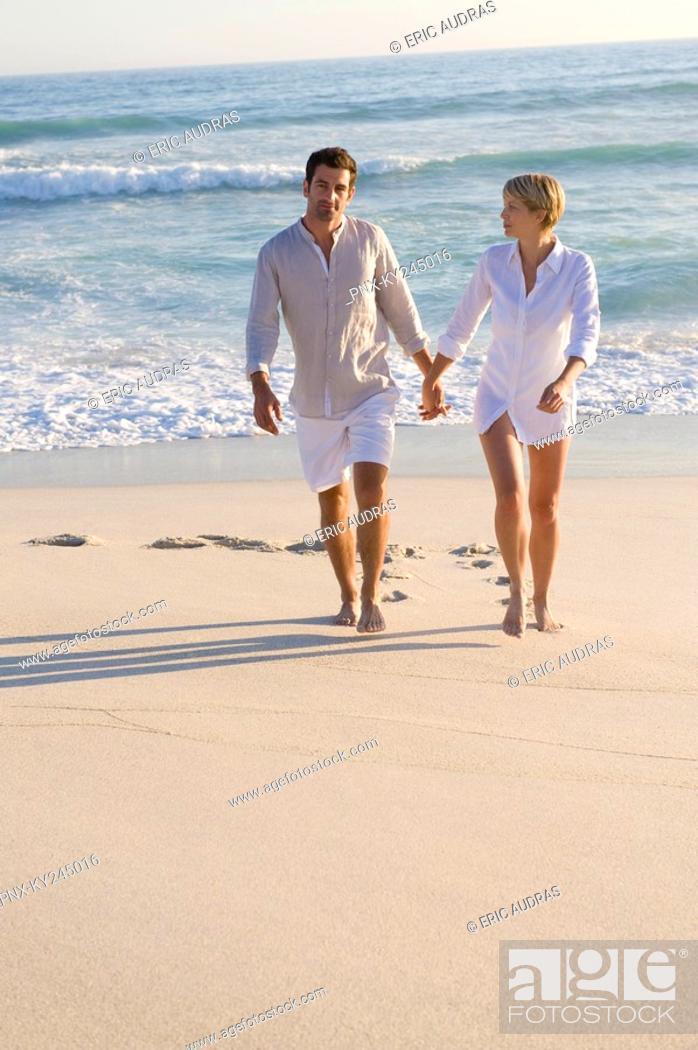 Stock Photo: Couple walking on the beach.