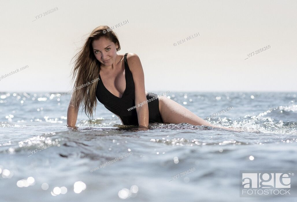 Stock Photo: Young woman at the beach.