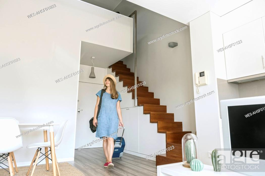 Stock Photo: Tourist entering modern vacation home.