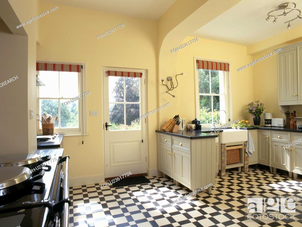 Black White Vinyl Flooring In Pastel Yellow Country Kitchen Stock Photo Picture And Rights Managed Image Pic Foh U23617726 Agefotostock