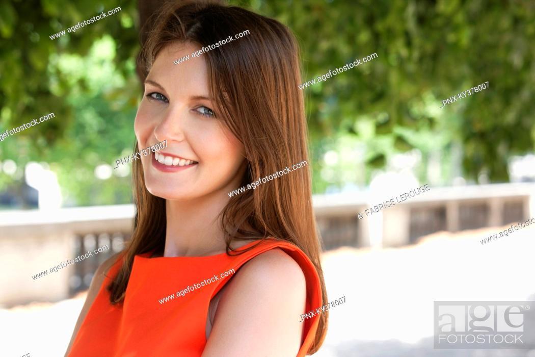 Stock Photo: Portrait of a woman smiling, Terrasse De l'Orangerie, Jardin des Tuileries, Paris, Ile-de-France, France.