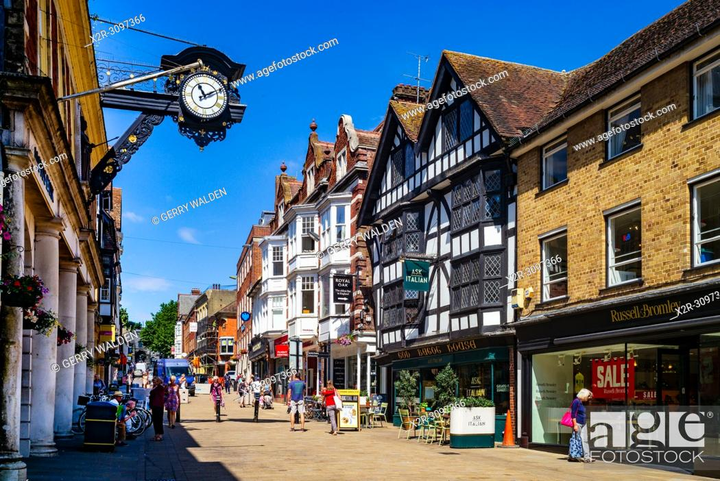 Stock Photo: Winchester High Street looking west towards The Castle and showing the clock above Lloyds Bank entrance.
