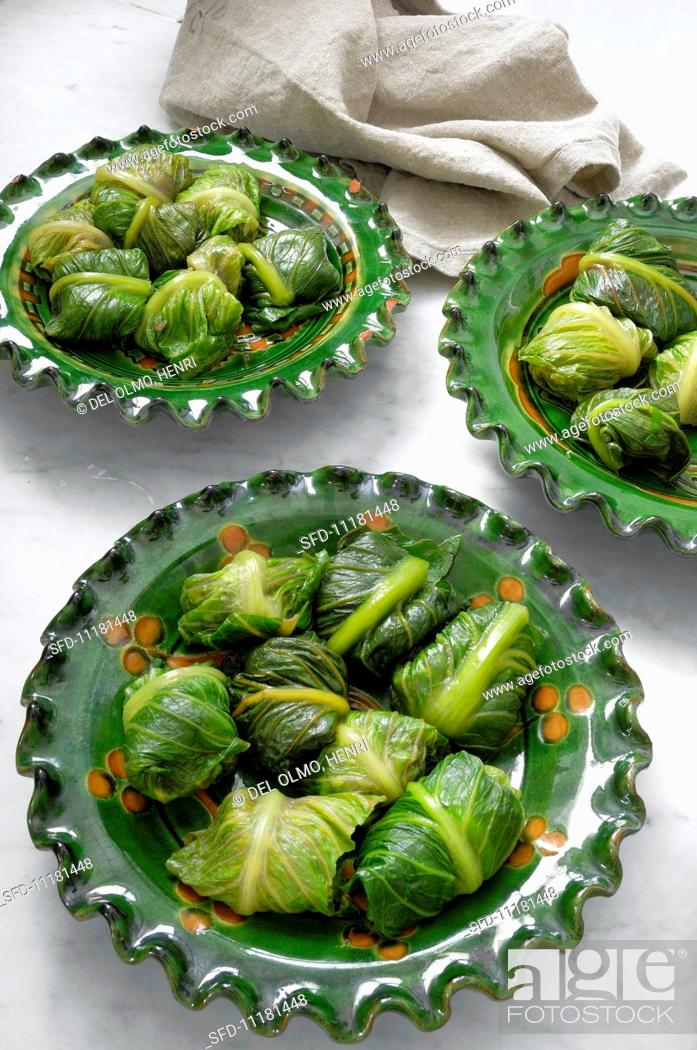 Stock Photo: Romaine lettuce parcels filled with minced meat and herbs.