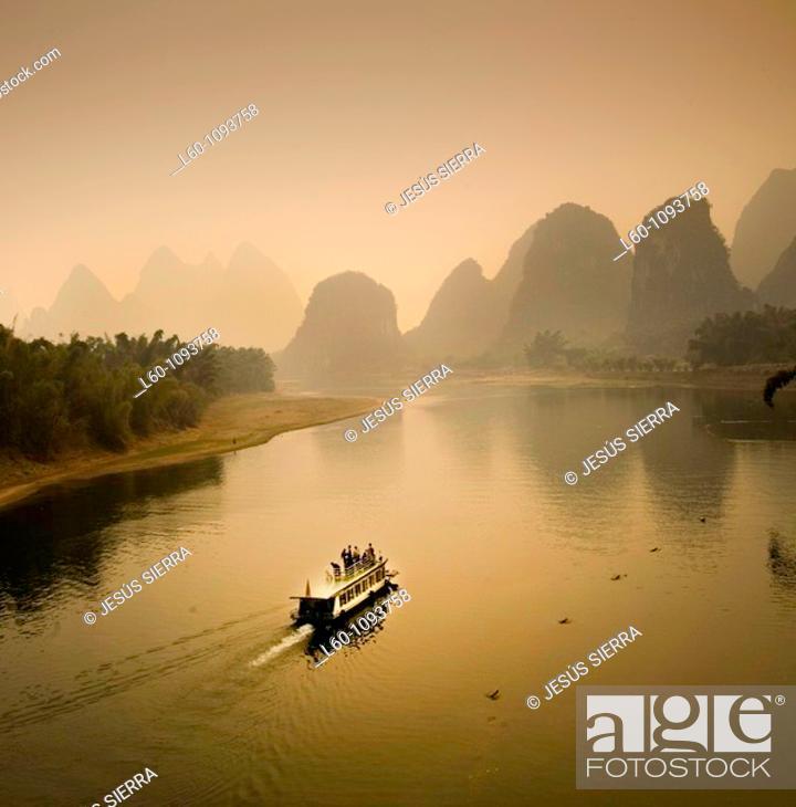 Stock Photo: Boat on the Li River, Yangshuo county, Guilin, Guangxi Province, China.
