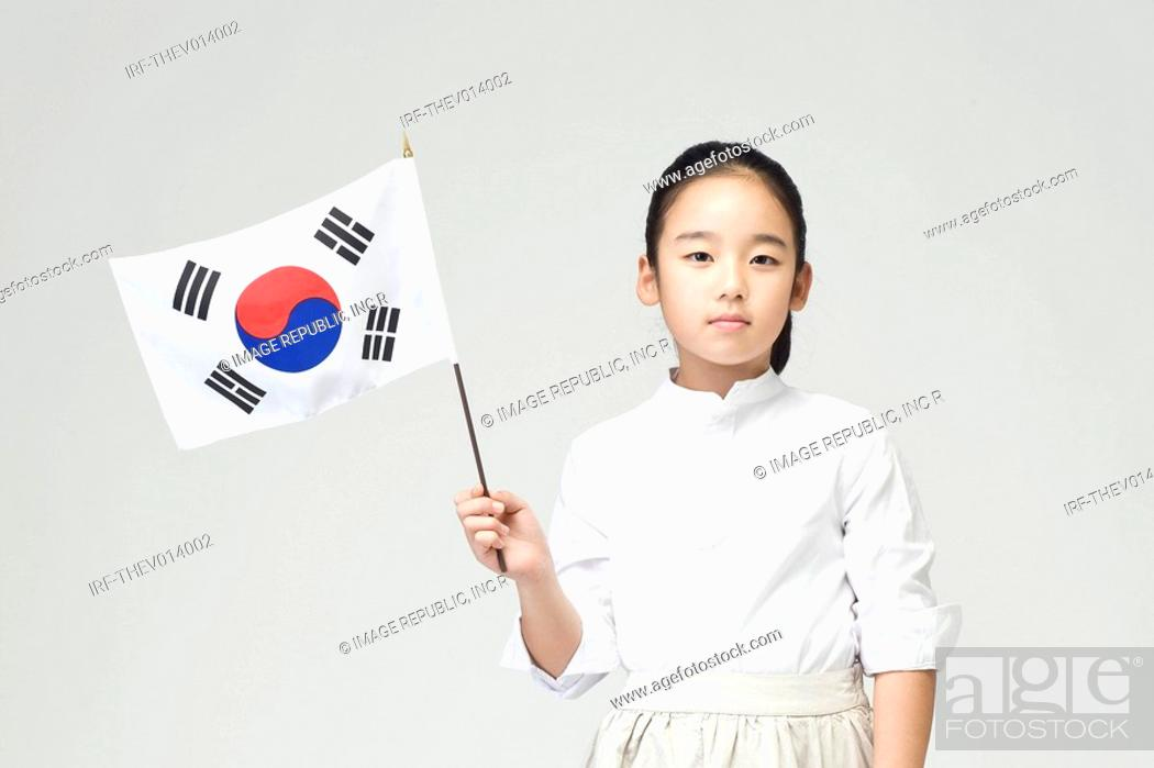 Stock Photo: girl holing Korean flag, Taegeukgi.