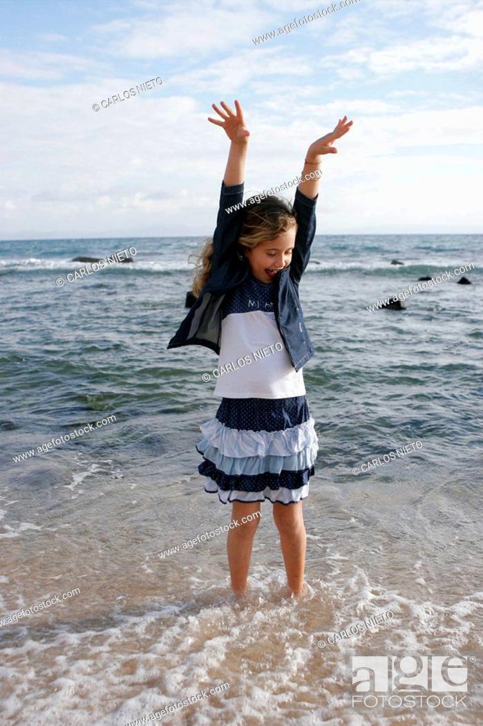 Stock Photo: Girl on the beach, Tarifa. Cadiz province, Andalusia, Spain.