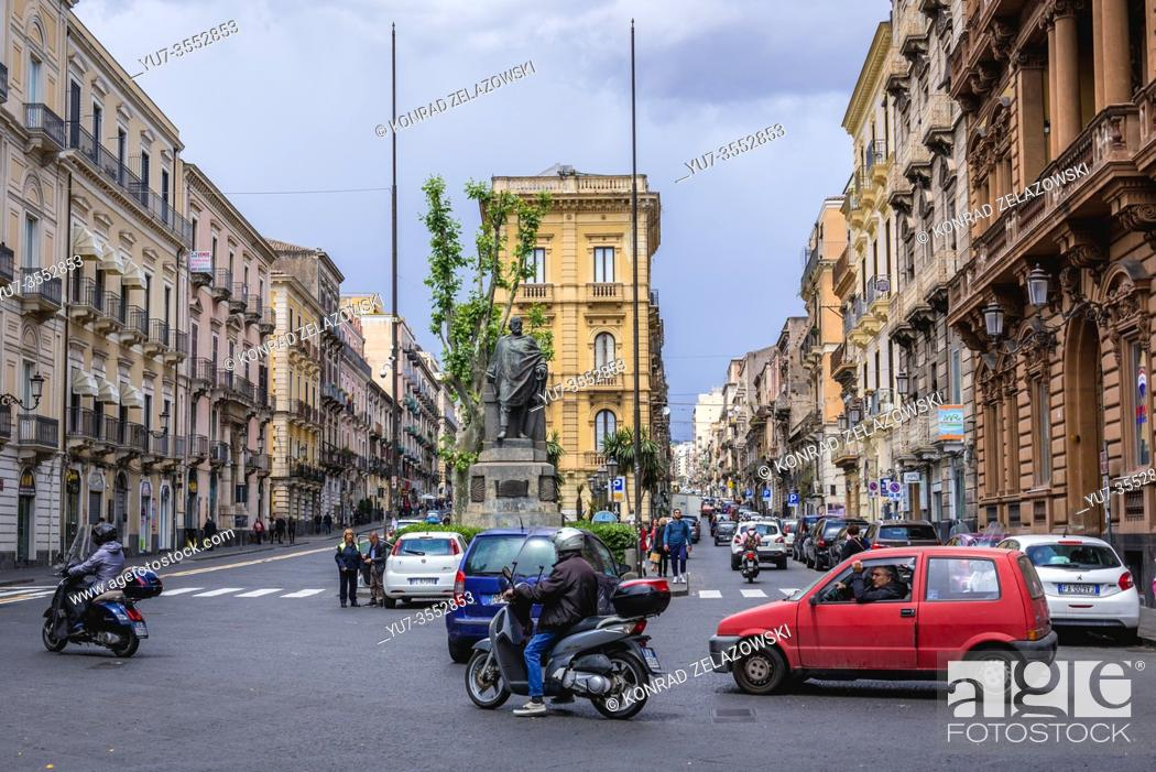 Stock Photo: Via Etnea and Via Caronda streets with Giuseppe Garibaldi statue in Catania, second largest city of Sicily island in Italy.