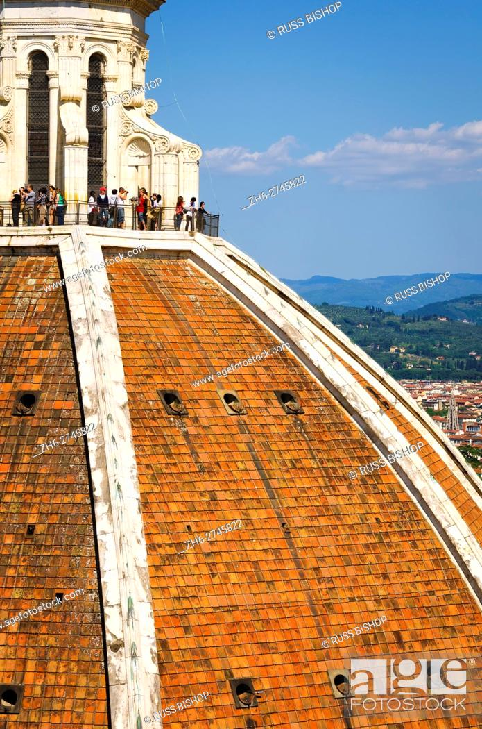 Stock Photo: Tourists on The Duomo dome from Giotto's Bell Tower (Campanile di Giotto), Florence, Tuscany, Italy.