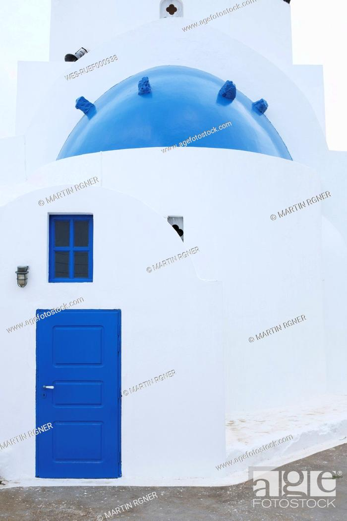 Stock Photo: Greece, View of classical whitewashed church at Oia village, close up.