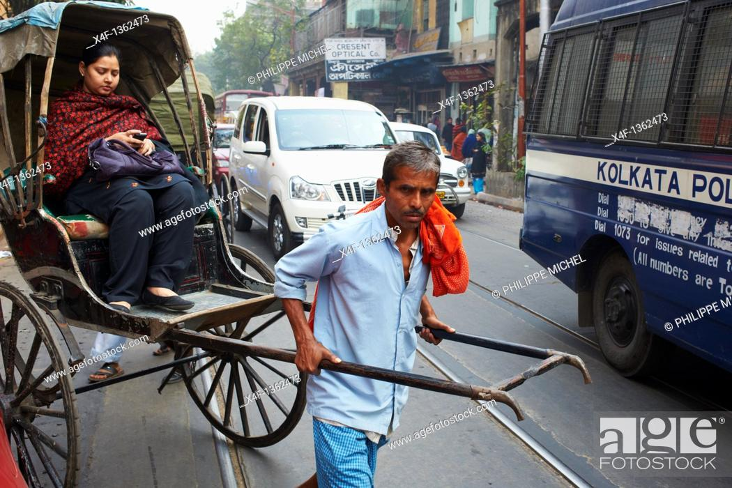 Stock Photo: India, West Bengal, Kolkata, Calcutta, rickshaw on the street.