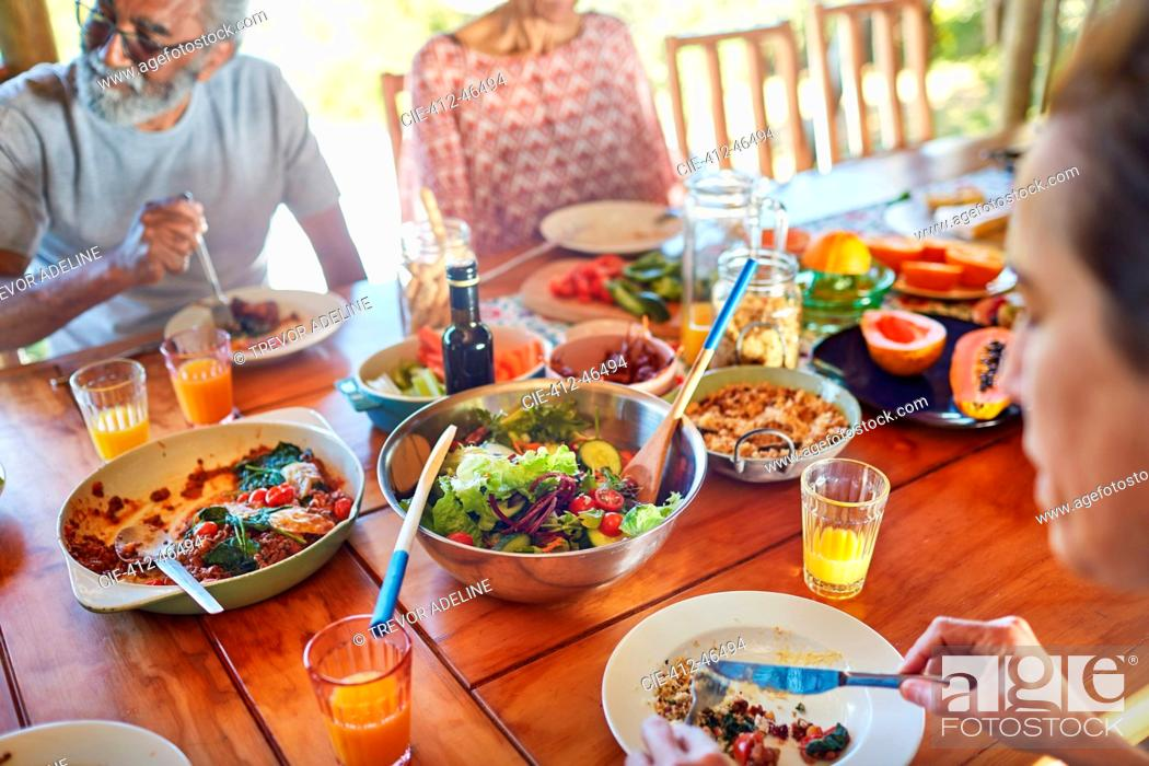 Stock Photo: Friends eating healthy meal during yoga retreat.