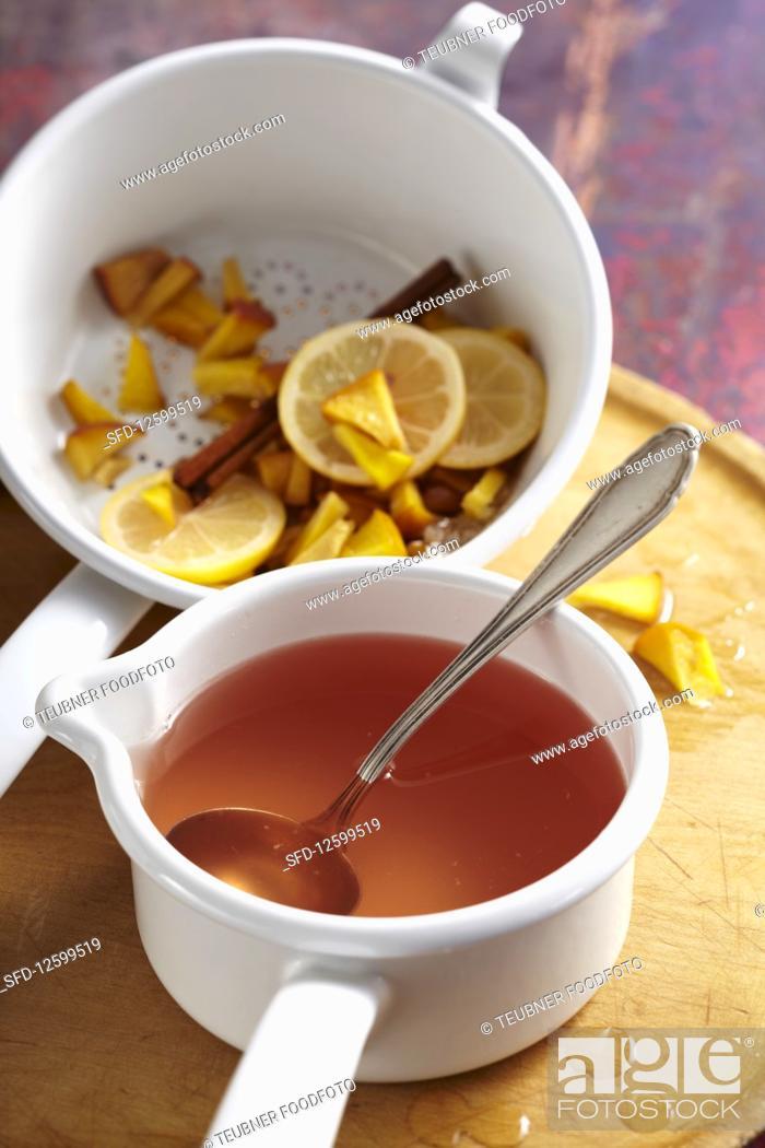 Homemade peach liqueur with cinnamon