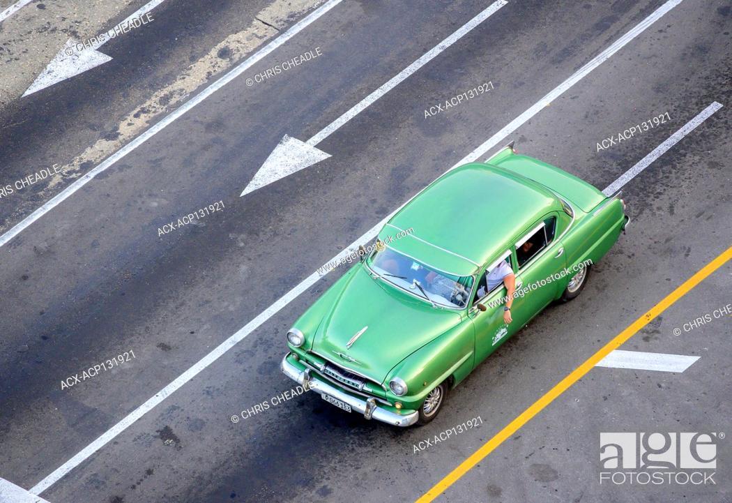 Stock Photo: Classic car on Malecon, Havana Vieja, Cuba.