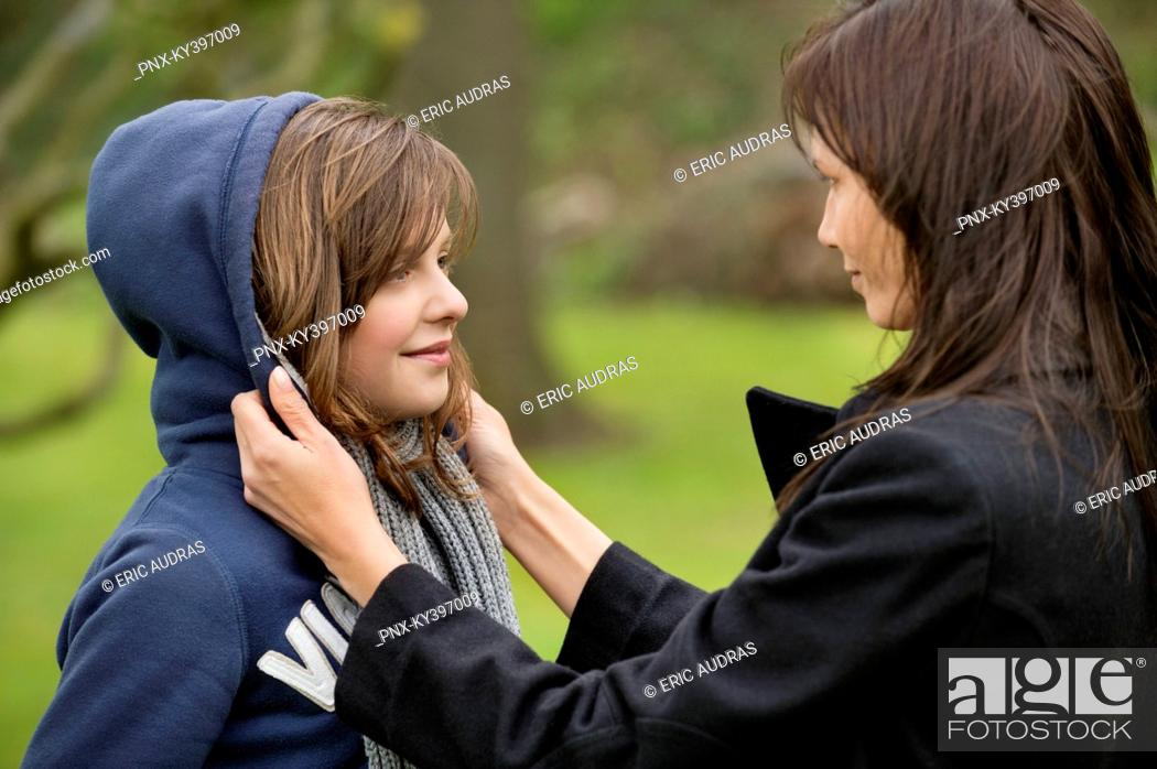 Stock Photo: Woman with her daughter in an orchard.