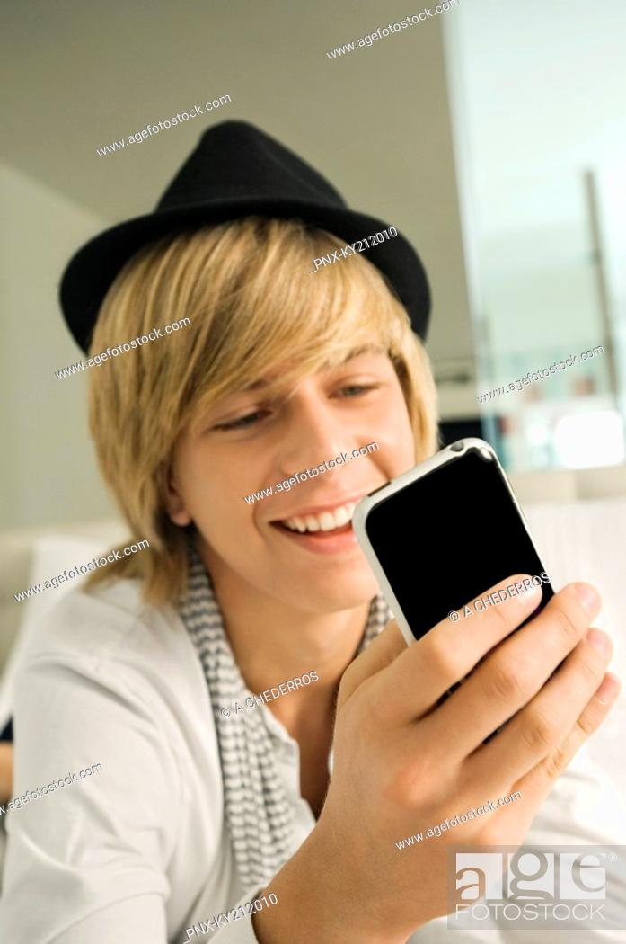 Stock Photo: Teenage boy using a mobile phone.