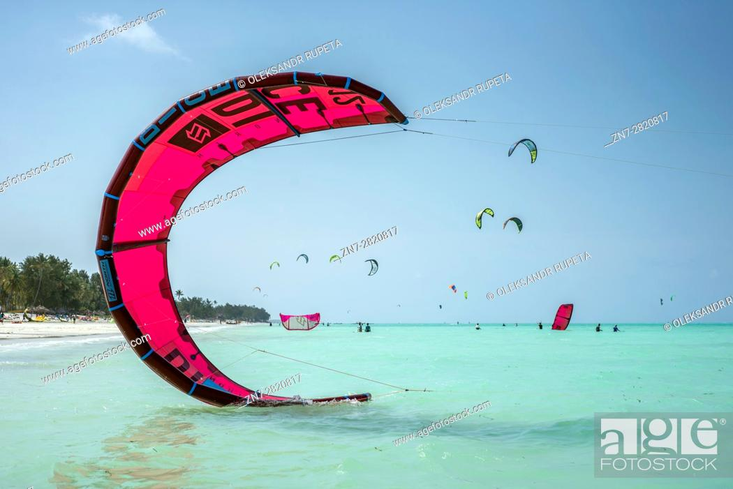 Stock Photo: Kitesurfing on a beach of Paje, Zanzibar, Tanzania. Paje is a windy place for good kiting and at the same time it is safe for beginners training.
