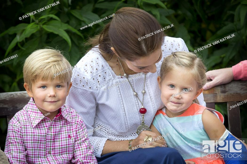 Stock Photo: Danish Crown Princess Mary, Pricne Vincent and Princess Josephine during a photo session during their summer holidays at Grasten Slot, Denmark, 25 July 2015.