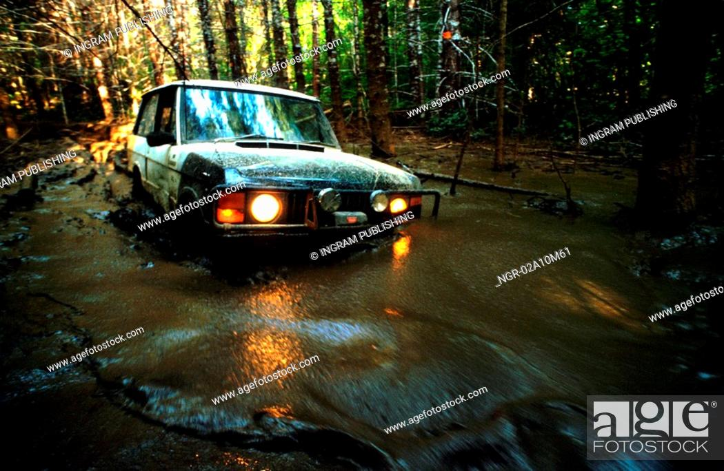Stock Photo: Four Wheel Drive in Water at Night.
