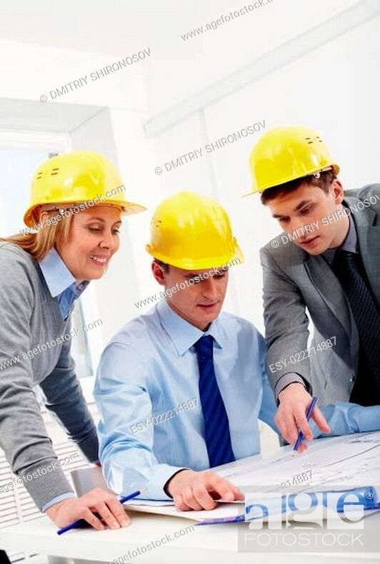 Stock Photo: Architects at discussion.