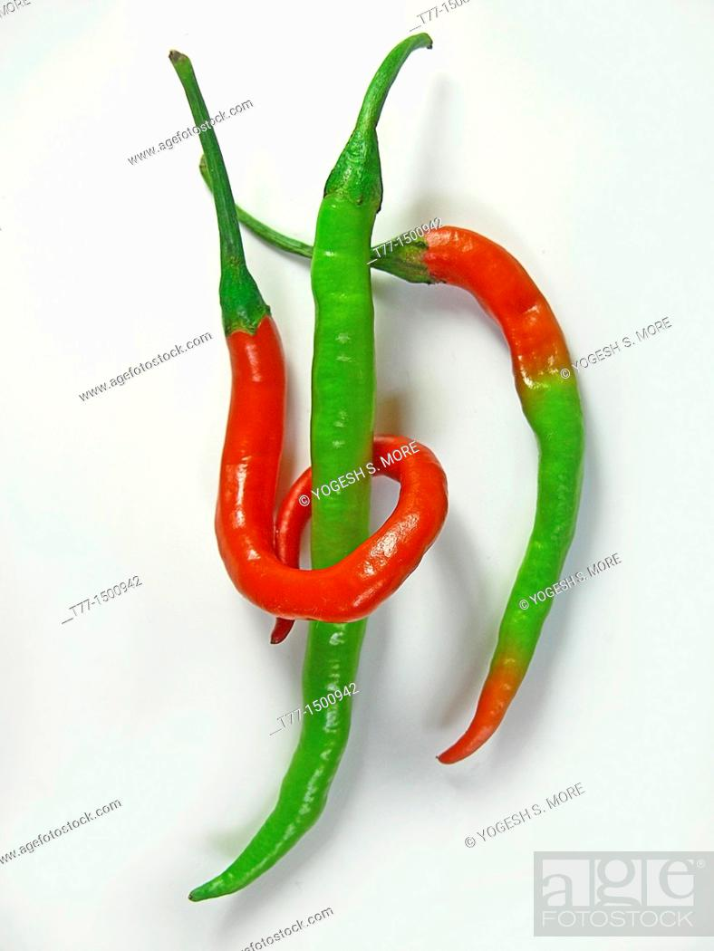 Stock Photo: Common Chili, Capsicum annuum, Red & green chilies are linked together.