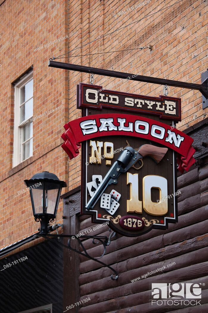 Stock Photo: USA, South Dakota, Black Hills National Forest, Deadwood, sign of the Number 10 Saloon, site of the murder of Wild Bill Hickok.