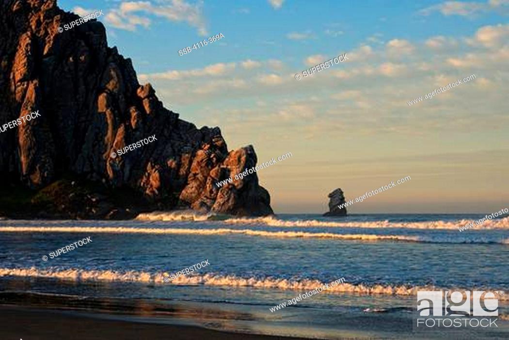 Stock Photo: Rock formations in an ocean, Morro Rock, Morro Bay, California, USA.