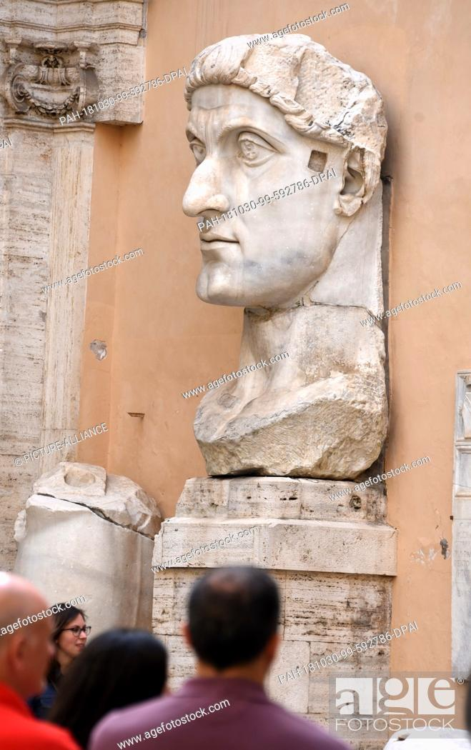 Stock Photo: 20 May 2018, Italy, Rome: In the Cortile (courtyard) of the conservator's palace there are fragments, including the 3-metre-high head of a collosal marble.