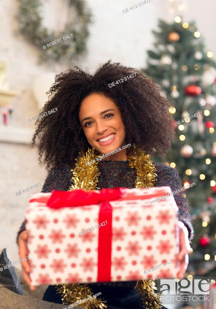 Stock Photo: Portrait smiling woman giving Christmas gift.