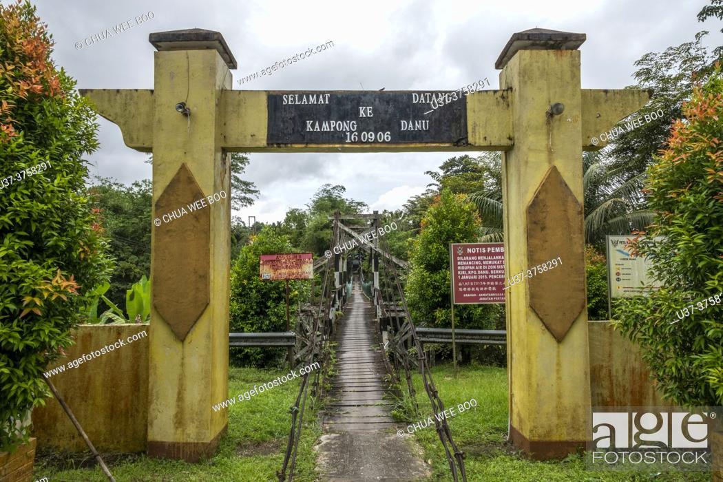 Stock Photo: A suspension bridge at Kampung Danu, Sarawak, East Malaysia.