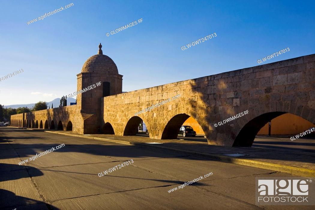 Stock Photo: Aqueduct along a road, Morelia, Michoacan State, Mexico.