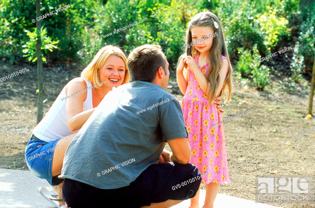 Stock Photo: Parents with daughter in the park.