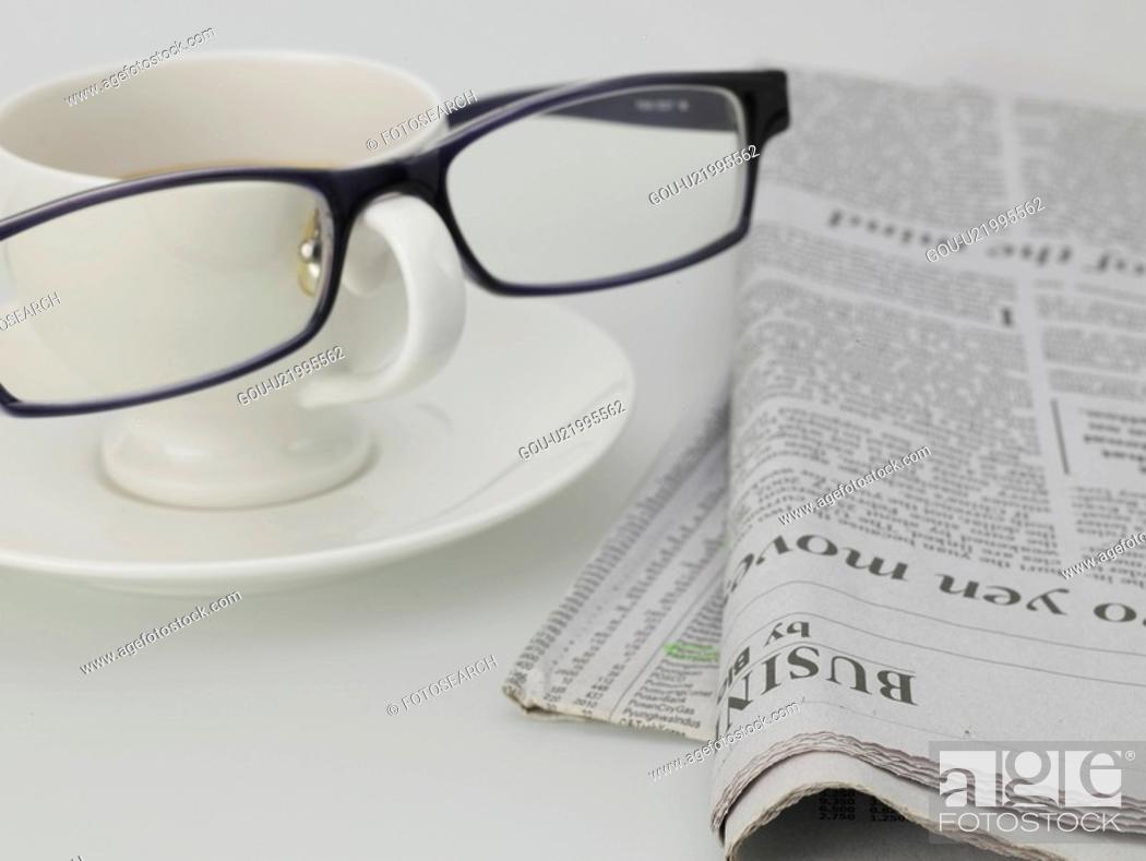 Stock Photo: food, newspaper, eyeglasses, saucer, coffee cup, cuisine, glasses.
