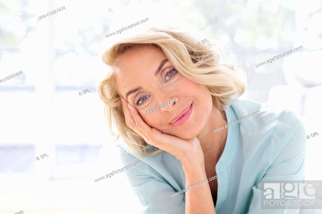 Stock Photo: Mature woman smiling and.