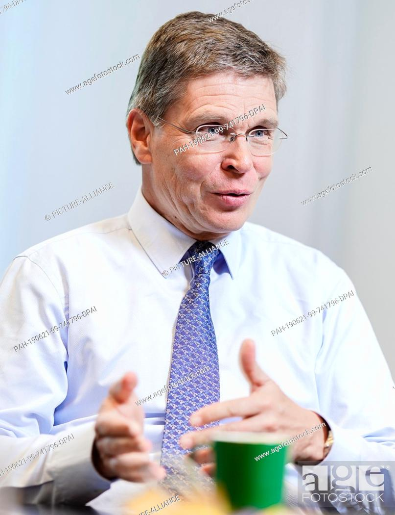Stock Photo: 17 June 2019, Rhineland-Palatinate, Ludwigshafen: Hans-Ulrich Engel, Vice Chairman and Chief Financial Officer of BASF SE, gestures during an interview.
