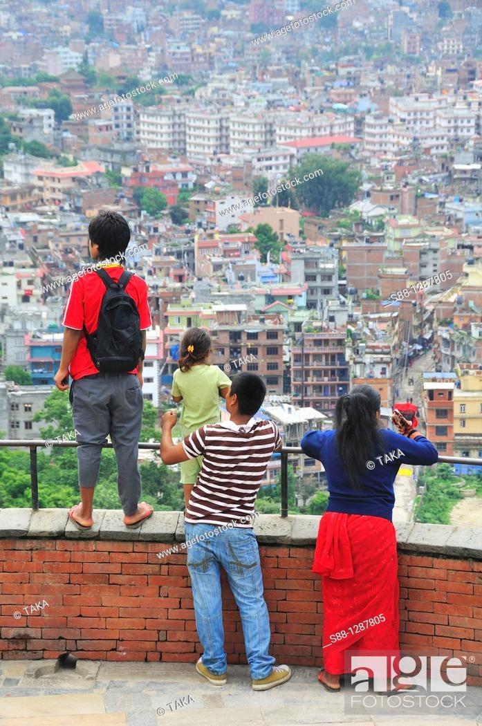 Stock Photo: Family looking at Kathmandu city from Swayambhunath temple, Nepal.
