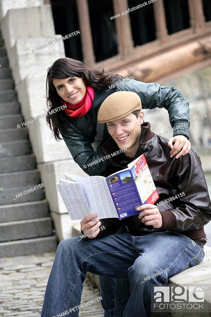 Stock Photo: France, Paris, pair, young, smiles, guides, map, look at,.