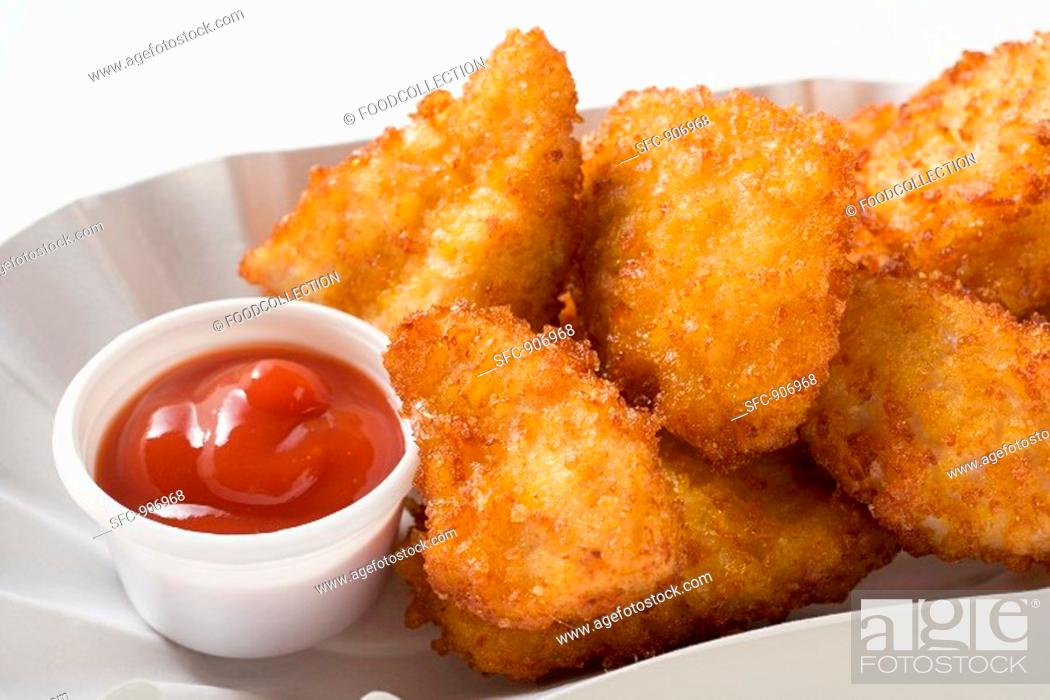 Stock Photo: Chicken nuggets with ketchup.