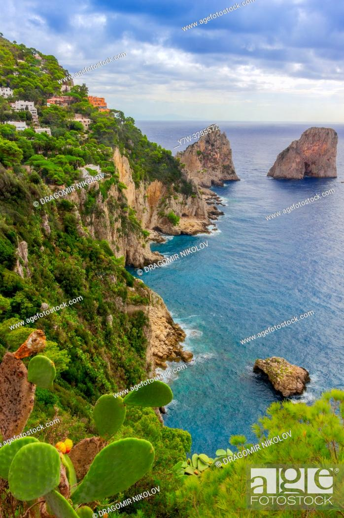 Stock Photo: Sea view by Capri island, Italy. The rocks are famous as Faraglioni rock. Locals say that they have seen sirens on this rock and often hear their whistling.