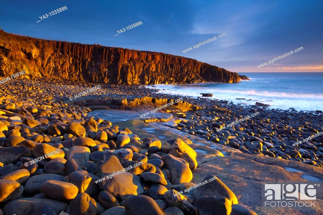 Stock Photo: England, Northumberland, Cullernose Point  Dawn light illuminates the rocky shoreline of Cullernose Point, near the village of Craster on the Northumberland.